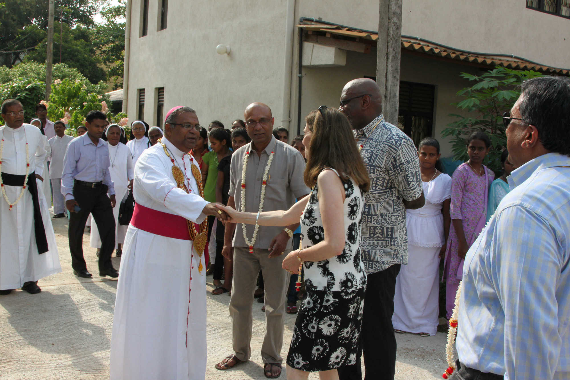 Frances Chanmugam meeting the priest at the home
