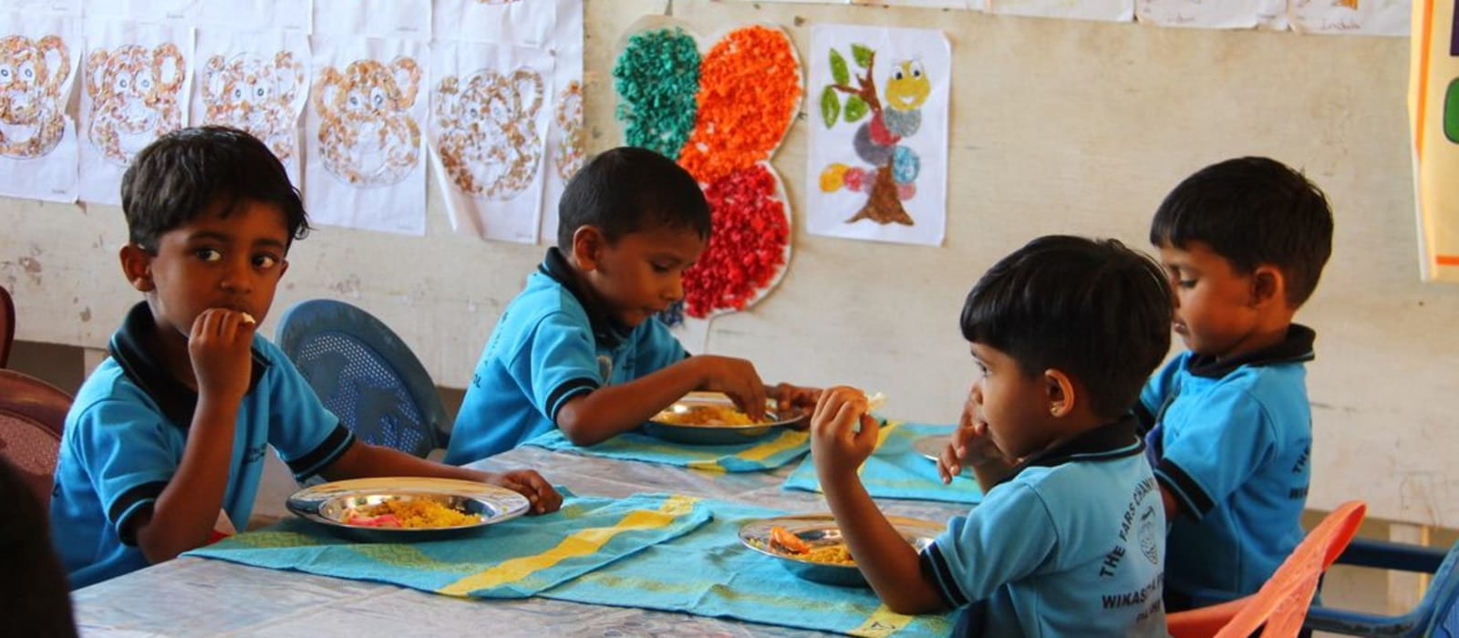 Pre-school children eating their meal at school
