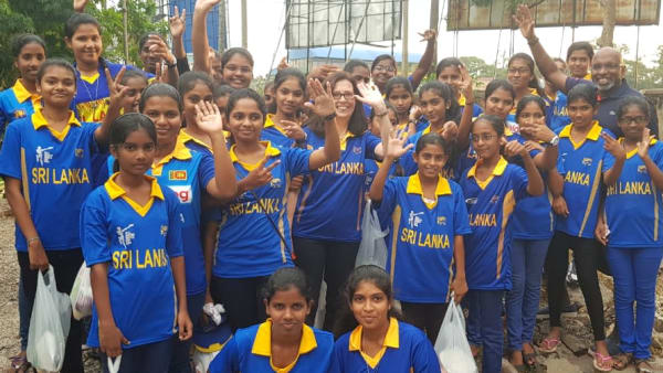 Group photo in cricket uniforms